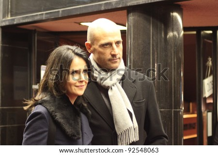 LONDON - JANUARY 10: Mark Strong and wife Liza Marshall attend the London film premier of 'Shame' at the Curzon cinema, Mayfair in London, England on January 10, 2012. - stock photo