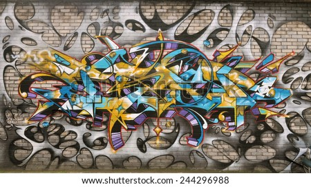 LONDON - JANUARY 11. Street art on brick wall on January 11, 2015, at Plough Yard, Shoreditch in the Borough of Tower Hamlets, an area renown for its street painting in east London, UK. - stock photo