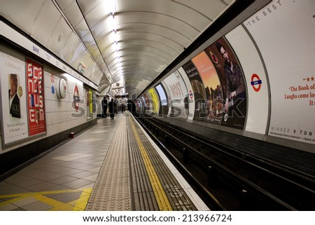 LONDON - JANUARY 8TH: The interior of bank station platform on January 8th, 2013 in London, england, uk. The london underground is the oldest underground system in the world. - stock photo