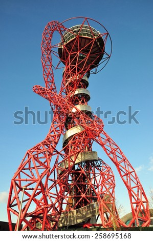 LONDON - JANUARY 24, 2015 The ArcelorMittal Orbit observation tower is Britain's largest piece of public art, designed by Anish Kapoor and Cecil Balmond, located at Stratford, east London, UK. - stock photo