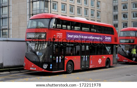 LONDON - JANUARY 18. The new Routemaster hybrid double deck buses have three doorways, two staircases and accommodate 80 passengers, January 18, 2014 in Hammersmith bus station, London, UK.  - stock photo