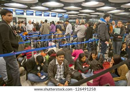 LONDON - JANUARY 18, 2013: Thousands of travelers stuck at Heathrow airport due to the heavy snowing on January 18, 2013 in London.