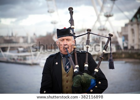 LONDON - January 4, 2016:: Unidentified bagpiper on the Westminster Bridge on Feb 16, 2016 in London. - stock photo