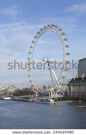 LONDON - JANUARY 9, 2015: View of the London Eye in daytime. London Eye (135 m tall, diameter of 120 m) - a famous tourist attraction over river Thames in the capital city London - stock photo