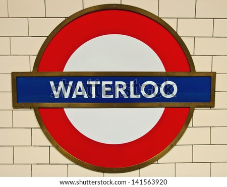 LONDON - JANUARY 26: Waterloo underground station sign in London, England on January 26, 2013. London's Metropolitan is the oldest underground railway in the world, dating from 1863 - stock photo