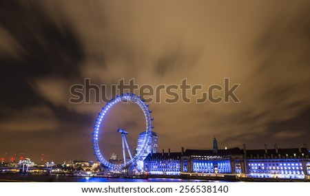 LONDON - JEN 16: View of London Eye on JENUARY 16, 2015 in London, England. London Eye is a famous tourist attraction at a height of 135 metres (443 ft) the biggest Ferris wheel in Europe. - stock photo