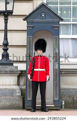 LONDON - JUL 1, 2015: Queen's Guard at Buckingham Palace. - stock photo