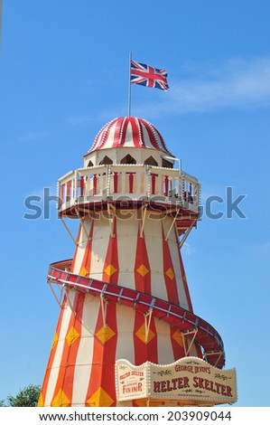LONDON - JULY 3. A Helter Skelter on July 3, 2014, at the new Queen Elizabeth Olympic Park, a landscaped public area with entertainment, art, recreation and sports attractions, in Stratford, London. - stock photo