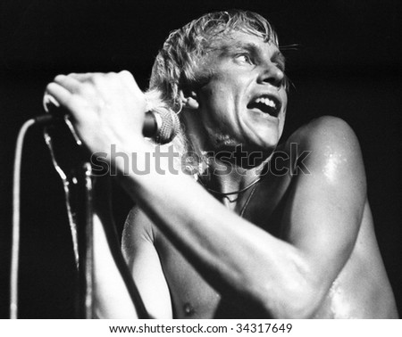 LONDON-JULY 21: Andy Ellison, lead singer of British pop group Radio Stars, performs live on stage on July 21, 1978 in London. He had previously been in John's Children with the late Marc Bolan.