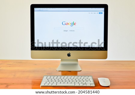 LONDON - JULY 01: APPLE iMac with Google website displayed on screen. July 01, 2014 in London, UK. - stock photo