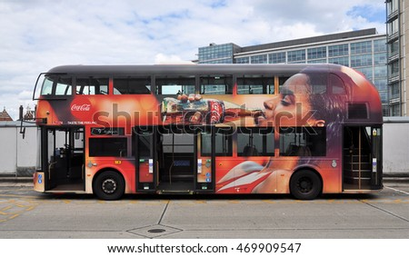 LONDON �� JULY 31, 2016. Applied graphics advertise Coca-Cola on a London Transport Routemaster diesel-electric hybrid double deck bus, parked at Hammersmith bus station, west London, UK.