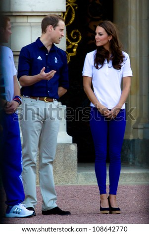 LONDON - JULY 26:  Kate Middleton, Prince William and Prince Harry are seen outside Buckingham Palace waving to crowds, July 26, 2012 in London, Uk - stock photo