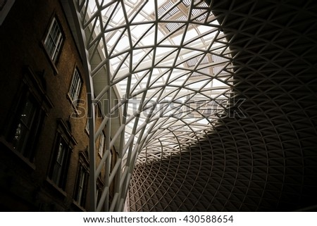LONDON - JULY 13, 2015:  King's Cross railway station. Kings Cross railway station interior on July 13, 2015 in London, UK. Opened in 1852, it is the southern terminus of the East Coast Main Line - stock photo