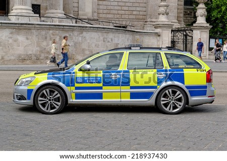 LONDON - JULY 1: London Metropolitan Police vehicle on July 1, 2014 in London. The Met was formed in 1829 and as of 2011 employed 48,661 staff making it one of biggest employers in London. - stock photo
