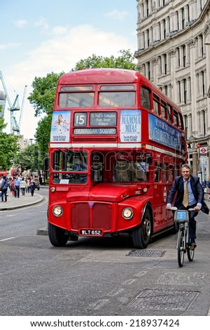 LONDON - JULY 1: Red Routemaster Double Decker Bus on the street in the City of London on July 1, 2014 in London, UK. These old double-decker buses are one of the most iconic symbol of London. - stock photo