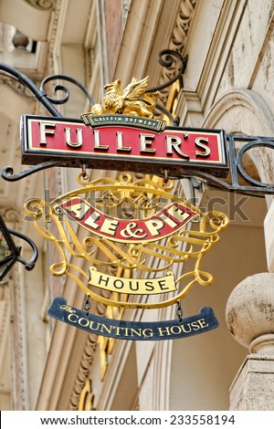 LONDON - JULY 01, 2014: Sign of the Fullers chain of pubs. The Counting House pub  on 50 Cornhill, London EC3V was built in 1893 as a magnificent banking hall.  - stock photo