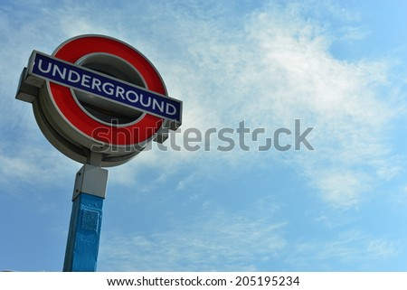 LONDON - July 8 2014: sign of the London Underground on July 8 , 2014 in London. The London Underground is the oldest underground of the world., Seven Sisters London Underground Station - stock photo