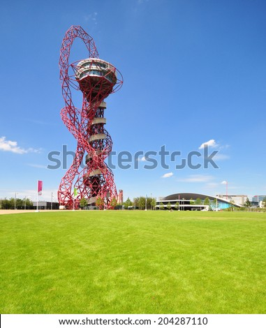 LONDON - JULY 3. The ArcelorMittal Orbit at the new Queen Elizabeth Olympic Park on July 3, 2014, a legacy of the Olympic Games designed by Anish Kapoor and Cecil Balmond, at Stratford, London. - stock photo
