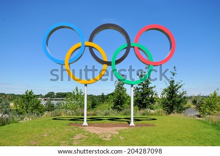 LONDON - JULY 3. The Olympic Games symbol in the new Queen Elizabeth Olympic Park, on July 3, 2014, a legacy from the games in the large landscaped recreation area at Stratford, east London. - stock photo