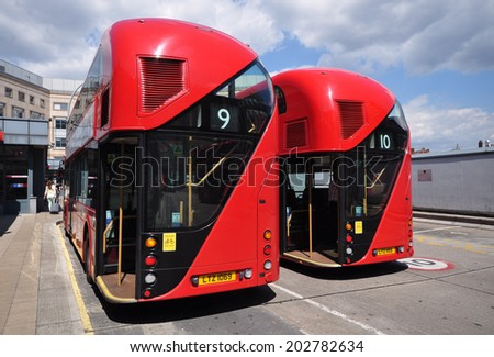 LONDON - JULY 1. Two new Routemaster diesel-electric hybrid double deck buses each accommodating 80 passengers with three doorways and two staircases, on July 1, 2014, at Hammrersmith, London.  - stock photo