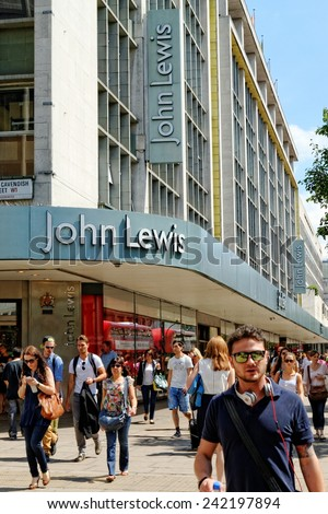 LONDON - JULY 1, 2014: Unidentified people passing by the John Lewis department store at Oxford street in central London. The chain was founded in 1864, and currently employs more than 38000 people.  - stock photo