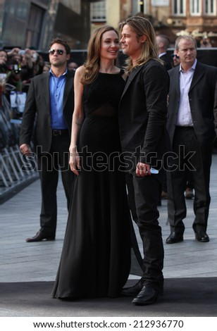 LONDON - JUN 02: Angelina Jolie and Brad Pitt attend the World War Z world premiere at the Empire Leicester Square on Jun 02, 2013 in London - stock photo