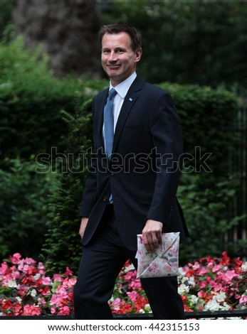 LONDON - JUN 14, 2016: Jeremy Hunt carrying a wrapped present arriving in Downing Street for the weekly cabinet meeting on Jun 14, 2016 in London
