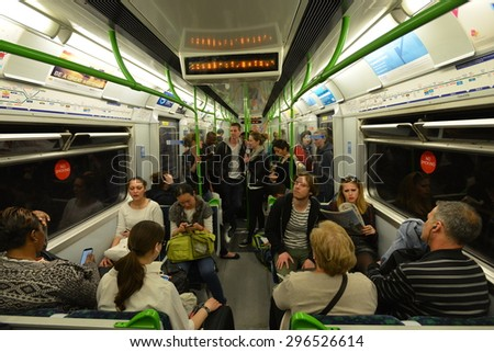 LONDON - JUN 16: People ride a Victoria Line underground train on Jun 16, 2015 in London, UK. Opened in 1863, the London Underground carried a record 1.26 billion passengers in the year 2013-2014. - stock photo