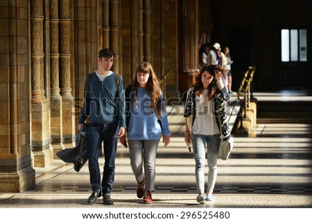 LONDON - JUN 16: People walk along a corridor in the Natural History Museum on Jun 16, 2015 in London, UK. Established in 1881 the museum houses 80 million items from around the world.  - stock photo