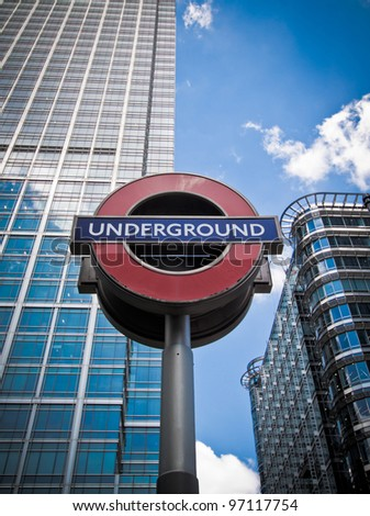 LONDON - JUN 3: The London Underground sign outside the Canary Wharf Station in London's Financial District on Jun 3, 2011. - stock photo