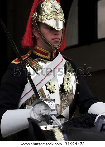LONDON - JUNE 06: A Horse Guard at the horse guard parade on 06 June 2009 in London, England. - stock photo