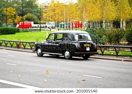 LONDON - JUNE 26 : A London Taxi or 'Black Cab' on June 26, 2014 in London, UK. All London cabs undergo a strict annual mechanical test before they are allowed to ply for hire.  - stock photo