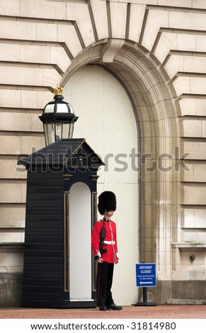 LONDON - JUNE 06: A Royal Guard at Buckingham Palace on 06 June 2009 in London, England.