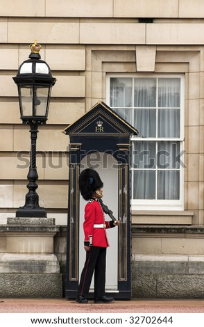 LONDON - JUNE 06: A Royal Guard at Buckingham Palace on June 6, 2009 in London, England. - stock photo