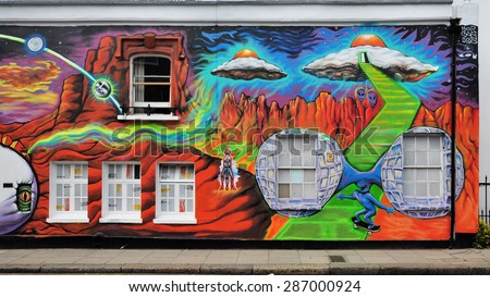 LONDON - JUNE 6, 2015. A temporary spray painted mural by artist Morganico on the Old Church Street facade of the Chelsea Arts Club in the Royal Borough of Kensington and Chelsea, London, UK.