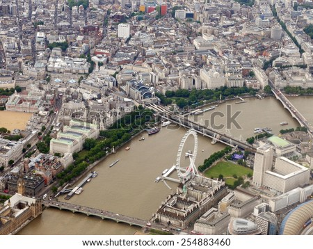 LONDON - JUNE 19: Aerial view of the River Thames as it runs through Westminster in the city centre of the British capital on June 19, 2010 in London, UK. The Thames is the longest river in England. - stock photo