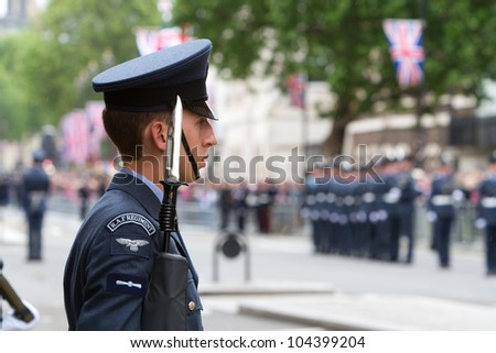 LONDON - JUNE 5: An unidentified soldier from the RAF in Whitehall as part of the Queen's carriage procession during the Diamond Jubilee celebrations on June 5, 2012 in London. - stock photo