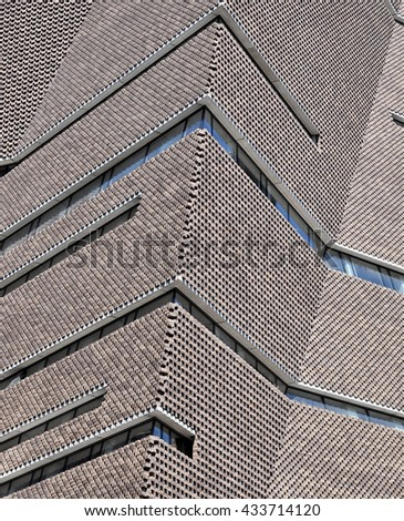 LONDON - JUNE 6, 2016. Architecural brickwork detail of the extension to the Tate Modern designed by Herzog & de Meuron, which filters daylight in and emits artificial light out, at Bankside, London. - stock photo