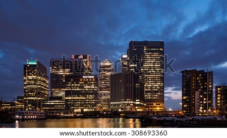 LONDON - JUNE 19, 2015: Canary Wharf buildings at night. Canary Wharf is the site of the tallest buildings and a major financial center in London.