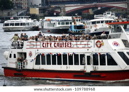 LONDON-JUNE 17: City Cruises tour boat, serving Westminster, London Eye, Greenwich piers everyday, sails on the Thames River, longest river in England with 346 km long on June 17, 2012 in London, UK - stock photo