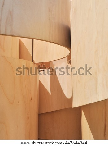 LONDON - JUNE 19, 2016. Detail of a Serpentine Gallery temporary summer house, designed by Barkow Leibinger, with undulating bands of plywood, in Kensington Gardens, London, UK.