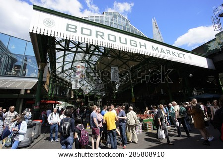 LONDON - JUNE 6, 2015: Entrances of London Borough Market, near London Bridge, one of the largest and oldest food open markets in London.    - stock photo