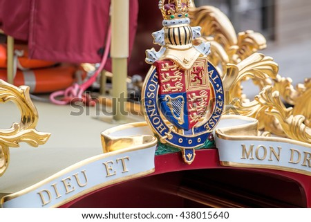 LONDON - JUNE 2, 2016: Gloriana Queen's Bow Barge. Royal Coat of Arms. - stock photo