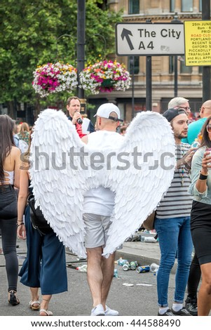 LONDON, JUNE 25, 2016: LGBT Gay Pride Parade, Man Wearing Angle Wings Costume - stock photo
