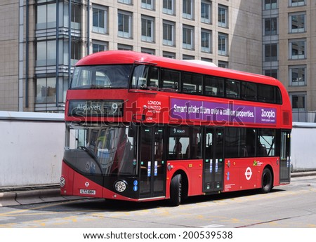 LONDON - JUNE 7. London's Routemaster diesel-electric hybrid double deck bus with three doorways and two staircases accommodates 80 passengers; June 7, 2014 at Hammersmith bus station, west London.  - stock photo