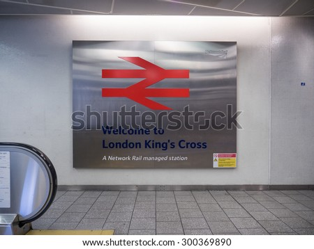 LONDON - JUNE 17, 2015: Network Rail symbol inside King's Cross railway station, a major London railway terminus which opened in 1852 on the northern edge of central London. - stock photo