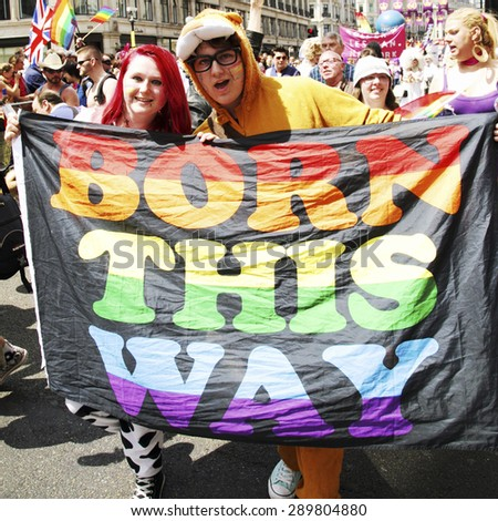 LONDON - JUNE 29: People take part in London's Gay Pride on June 29, 2013 in London, UK, estimated 25,000 people took part in the march, Parade to support gay rights. - stock photo