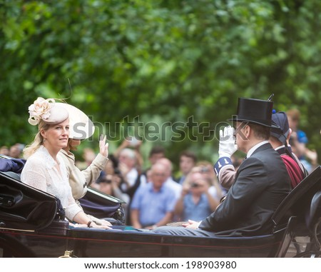LONDON - JUNE 14: Prince Edward, Earl of Wessex and Sophie, Countess of Wessex seating on the Coach at Queen's Birthday Parade, also known as Trooping the Colour, on June 14, 2014 in London, England. - stock photo