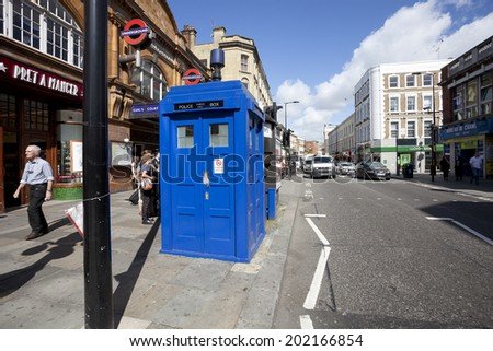 LONDON - JUNE 11, 2014: Public call police box with mounted a modern surveillance camera near Earl's Court tube station in London. - stock photo