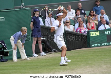 LONDON - JUNE 24: Rafael Nadal of Spain returns ball during second round match against Robin Haase of the Netherlands at Wimbledon in London, England on June 24, 2010 - stock photo